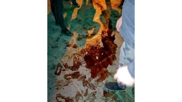 This Sunday, Jan. 12, 2020, photo provided by the New York-based Center for Human Rights in Iran, shows a pool of blood near Azadi, or Freedom, Square after police broke up a demonstration in Tehran, Iran. (Center for Human Rights in Iran via AP)