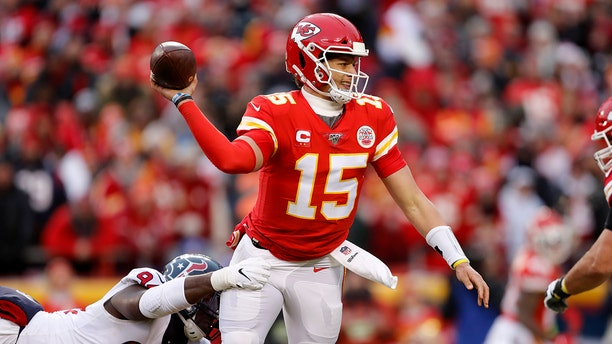 Kansas City Chiefs quarterback Patrick Mahomes (15) throws under pressure from Houston Texans defensive end Charles Omenihu (94) during the first half of an NFL divisional playoff football game, in Kansas City, Mo., Sunday. (AP Photo/Jeff Roberson)