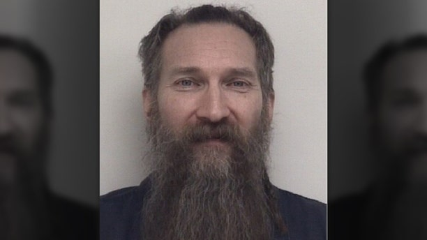 Mark Latunski, 50, is facing murder and mutilation of a body charges in the death of a man he had met on Grindr, a dating app for the LGBT community. (Shiawassee County Jail)