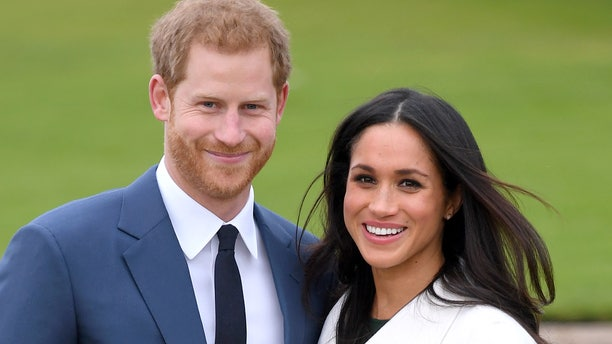 Prince Harry and Meghan Markle attend an official photocall to announce their engagement at The Sunken Gardens at Kensington Palace on Nov. 27, 2017 in London, England.