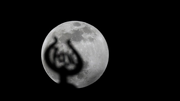 The Moon is seen during partial lunar eclipse over Istanbul, Turkey on January 10, 2020.