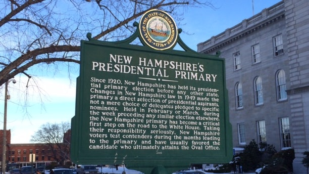 For 100 years, New Hampshire has held the first primary in the race for the White House. A sign marking the primary's history stands outside the Statehouse in Concord, N.H.