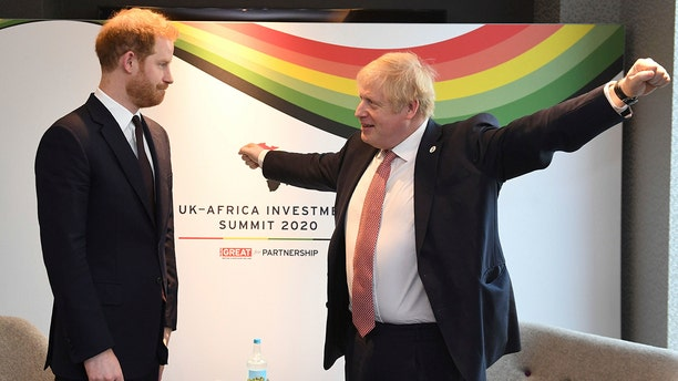Britain's Prince Harry and Prime Minister Boris Johnson, left, at the UK Africa Investment Summit in London, Monday Jan. 20, 2020. Boris Johnson is hosting 54 African heads of state or government in London. The move comes as the U.K. prepares for post-Brexit dealings with the world.