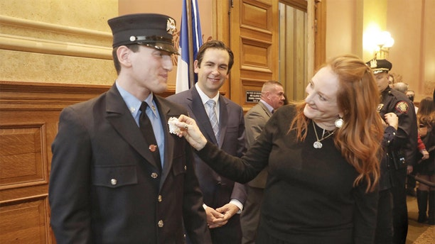 Patti Scialfa congratulates her son Sam Springsteen. (Jersey City Mayor's Office)