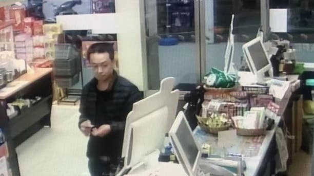 Surveillance from a convenience store showing a suspect in the disappearance and murder of a Chinese-Malaysian woman.
