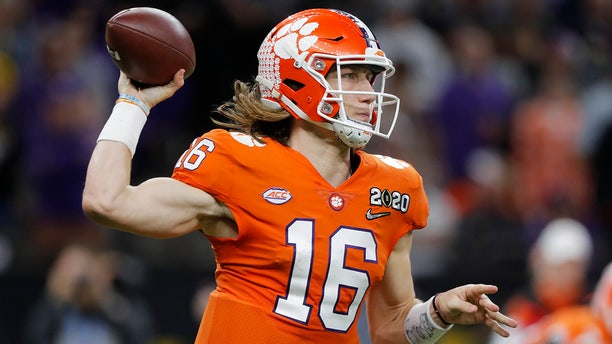 Clemson quarterback Trevor Lawrence passes against LSU during the second half of a NCAA College Football Playoff national championship game Monday, Jan. 13, 2020, in New Orleans. (AP Photo/Gerald Herbert)