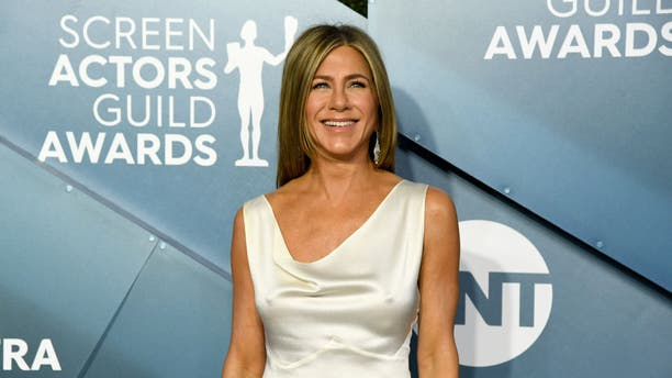 Jennifer Aniston left little to the imagination in a satin white dress at the 26th Annual Screen Actors Guild Awards at The Shrine Auditorium.