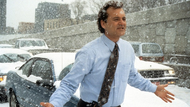 Actor Bill Murray runs through the snow in a scene from the film 'Groundhog Day,' 1993. (Photo by Columbia Pictures/Getty Images)