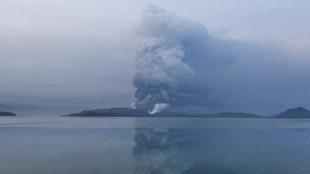 Taal volcano spews ash in a view from Batangas, southern Philippines on Monday, Jan. 13, 2020.