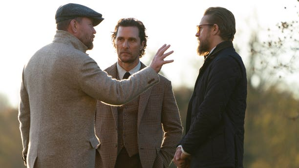 From l-r: Guy Ritchie, Matthew McConaughey, and Charlie Hunnam filming a scene from 'The Gentlemen.'