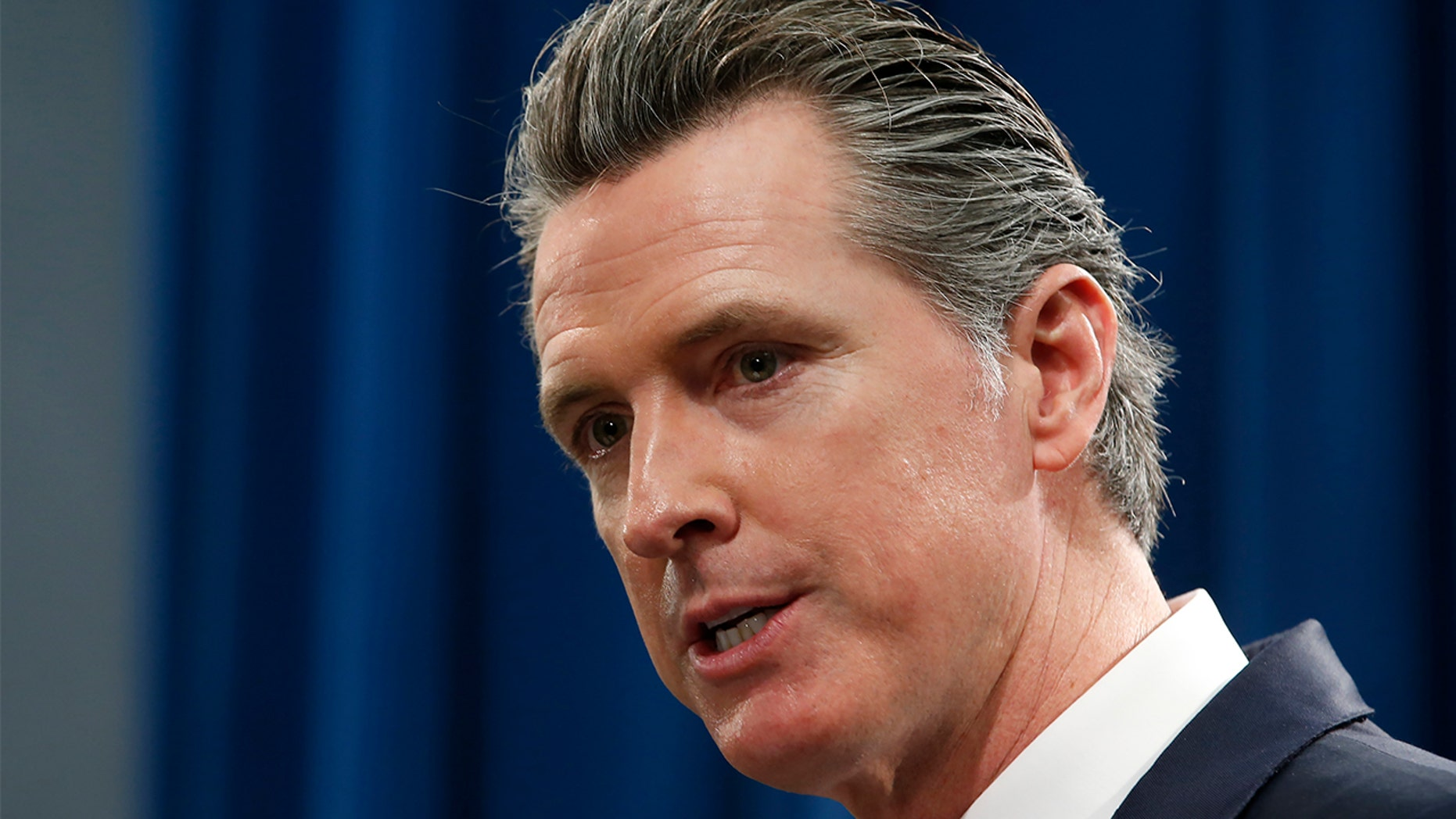 FILE - In this Jan. 10, 2020 file photo California Gov. Gavin Newsom responds to a reporters question during a news conference in Sacramento, Calif. Newsom announced Wednesday, Feb. 5, 2020. (AP Photo/Rich Pedroncelli, File)