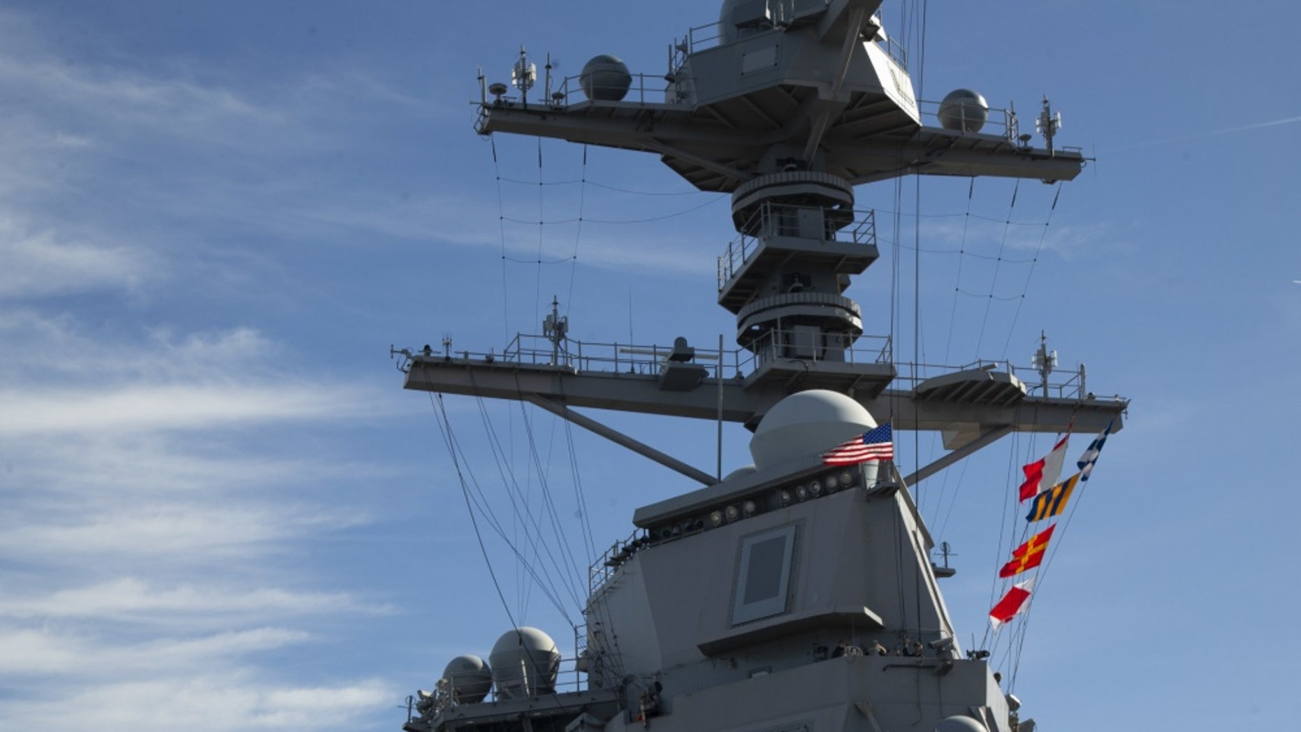 USS Gerald R. Ford (CVN 78) raises the American flag on it's mast as the ship get underway, Feb. 3, 2020 - file photo.