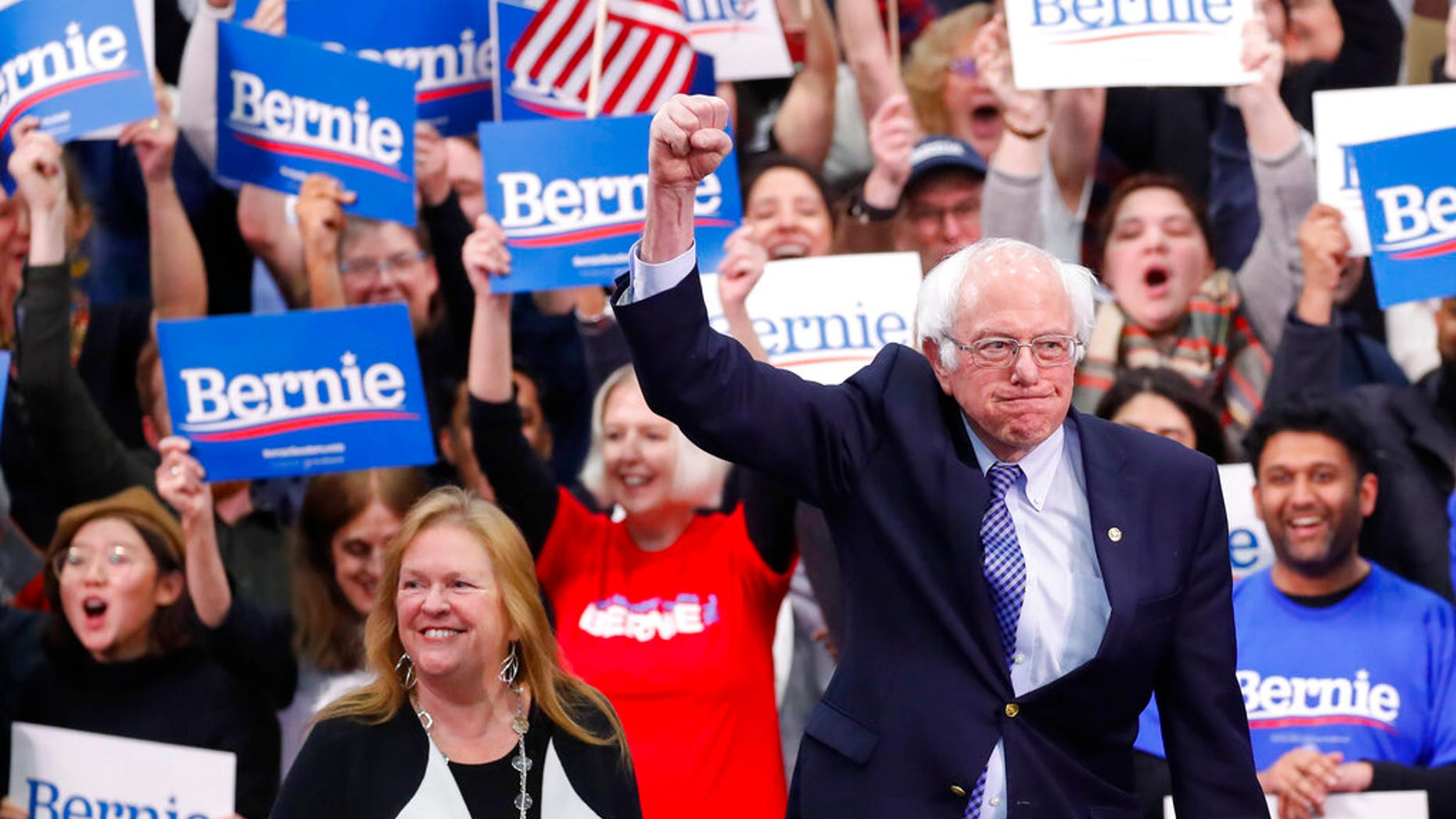 Democratic presidential candidate Sen. Bernie Sanders, I-Vt., with his wife Jane O'Meara Sanders, arrives to speak to supporters at a primary night election rally in Manchester, N.H., Tuesday, Feb. 11, 2020. (AP Photo/Pablo Martinez Monsivais)