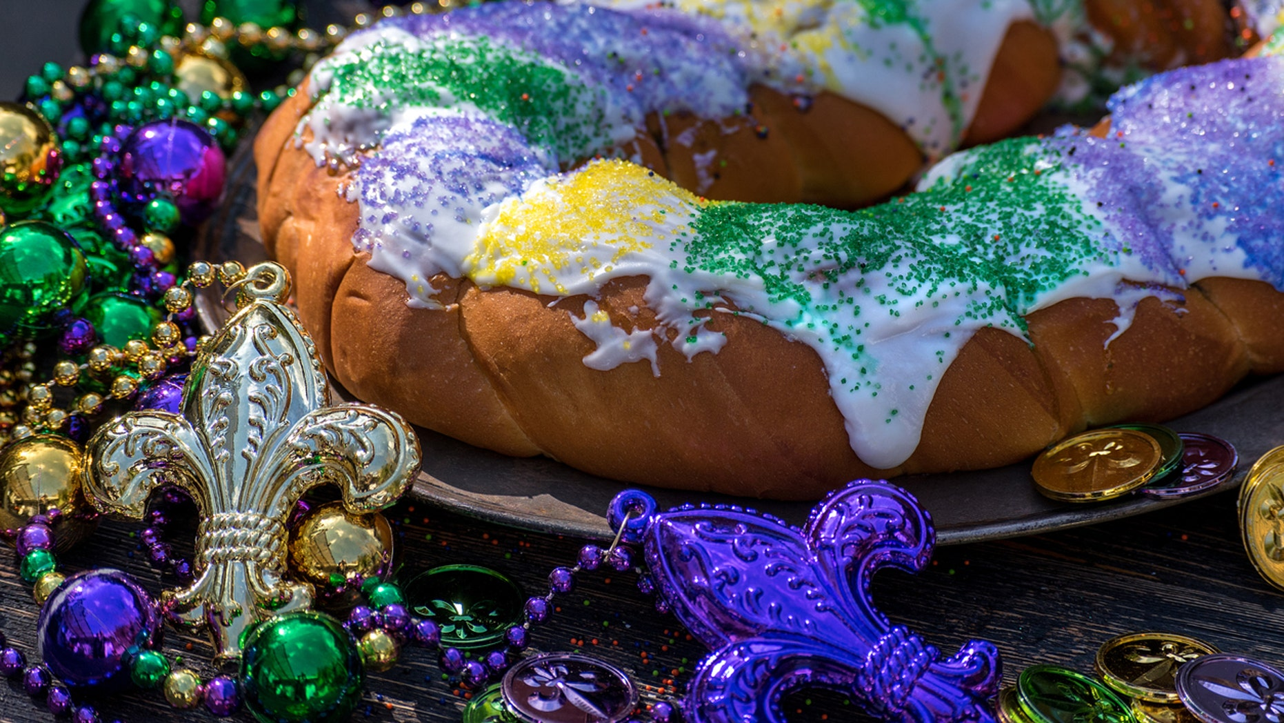 What exactly is the tri-colored confection that makes an appearance at Mardi Gras celebrations across the country?