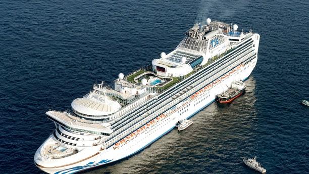 Cruise ship Diamond Princess is anchored off the shore of Yokohama, south of Tokyo, Wednesday, Feb. 5, 2020.(Hiroko Harima/Kyodo News via AP)