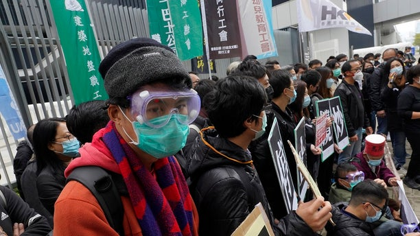 Medical staff strike over coronavirus concerns outside government headquarters in Hong Kong on Wednesday.(AP Photo/Vincent Yu)