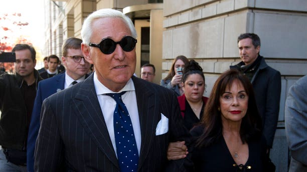 FILE - In this Nov. 15, 2019, file photo, Roger Stone, left, with his wife Nydia Stone, leaves federal court in Washington, Friday, Nov. 15, 2019. Federal prosecutors are asking a judge to sentence Stone to serve between 7 and 9 years in prison after his conviction on witness tampering and obstruction charges. (AP Photo/Jose Luis Magana, File)
