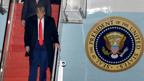 President Donald Trump walks down the stairs of Air Force One upon his arrival at Manchester-Boston Regional Airport, Monday, Feb. 10, 2020, in Manchester, N.H., for a campaign rally. (AP Photo/Steven Senne)