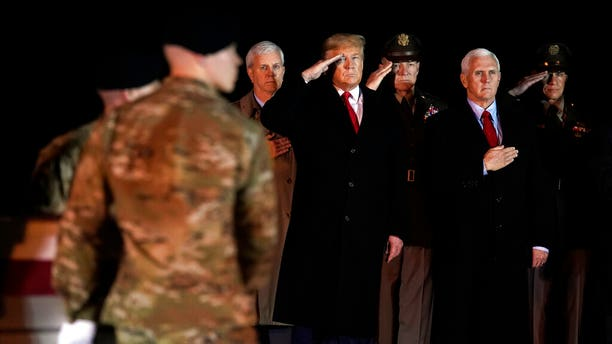 President Donald Trump and Vice President Mike Pence watch as a U.S. Army carry team moves a transfer case containing the remains of Sgt. 1st Class Javier Gutierrez, of San Antonio, Texas, Monday, Feb. 10, 2020, at Dover Air Force Base, Del. According to the Department of Defense both Gutierrez and Sgt. 1st Class Antonio Rodriguez, of Las Cruces, N.M., died Saturday, Feb. 8, during combat operations in Afghanistan. (AP Photo/Evan Vucci)
