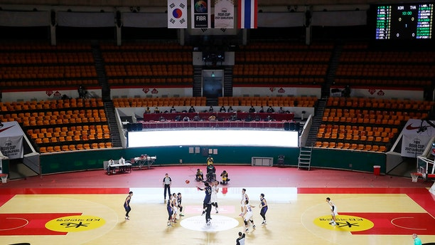 In an empty seat stadium, the 2021 FIBA Asia Cup qualifiers group A basketball game between South Korea and Thailand Sunday, Feb. 23, 2020, in Seoul, South Korea. The basketball game held without spectators as a precaution against the COVID-19. (Hong Hae-in/Yonhap via AP)