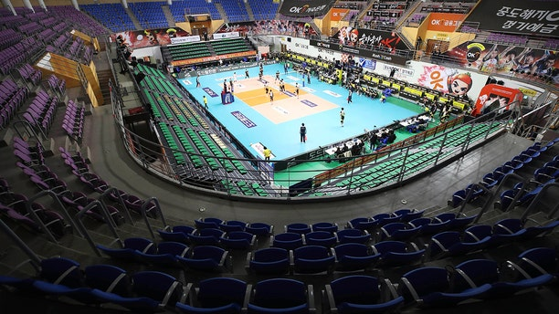 Stadium seats are empty during the pro volleyball V-league between OK Savingbank Rush&Cash and KB Insurance Stars in Ansan, South Korea, Wednesday, Feb. 26, 2020. The volleyball game held without spectators as a precaution against the COVID-19. (Hong Ki-won/Yonhap via AP)
