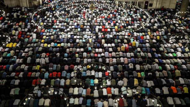Turkey's Muslims offer prayers during the first day of Eid al-Fitr, which marks the end of the holy fasting month of Ramadan, at the Suleymaniye Mosque in Istanbul, early Tuesday, June 4, 2019. (AP Photo/Emrah Gurel)