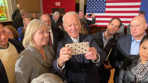 Former Vice President Joe Biden takes selfies with supporters during a campaign event in Somersworth, NH on Feb. 5, 2020