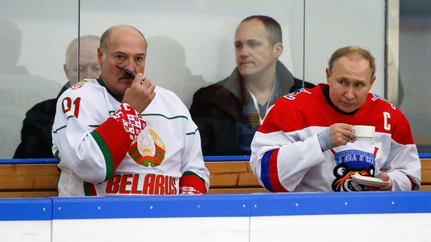 Russian President Vladimir Putin and Belarusian President Alexander Lukashenko take a break during an exhibition match in Sochi, Russia, on Friday. (Reuters)