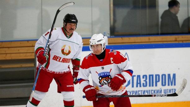 Russian President Vladimir Putin and Belarusian President Alexander Lukashenko hit the rink in Sochi. (Reuters)