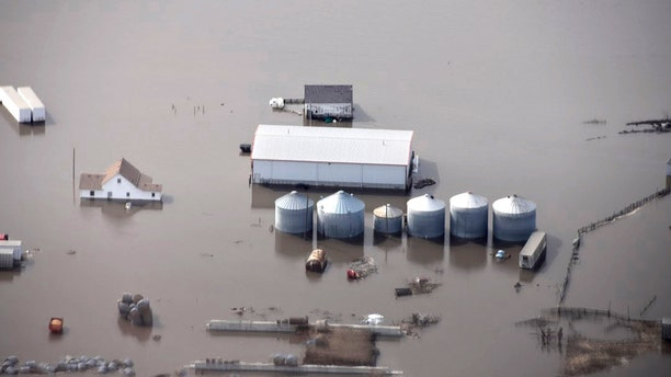 This March 2019, file photo, taken by the South Dakota Civil Air Patrol and provided by the Iowa Department of Homeland Security and Emergency Management shows flooding along the Missouri River in rural Iowa north of Omaha, Neb.