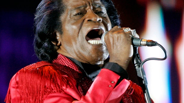 In this July 6, 2005 file photo, James Brown performs on stage during the Live 8 concert at Murrayfield Stadium in Edinburgh, Scotland.