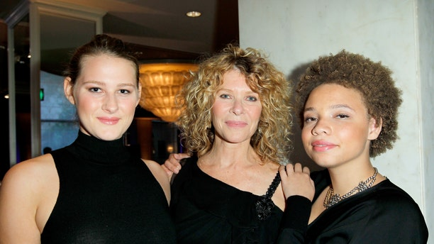 Actress Kate Capshaw (center), and daughters Mikaela George Spielberg (right) and Destry Allyn Spielberg (left) attend an even in 2013.