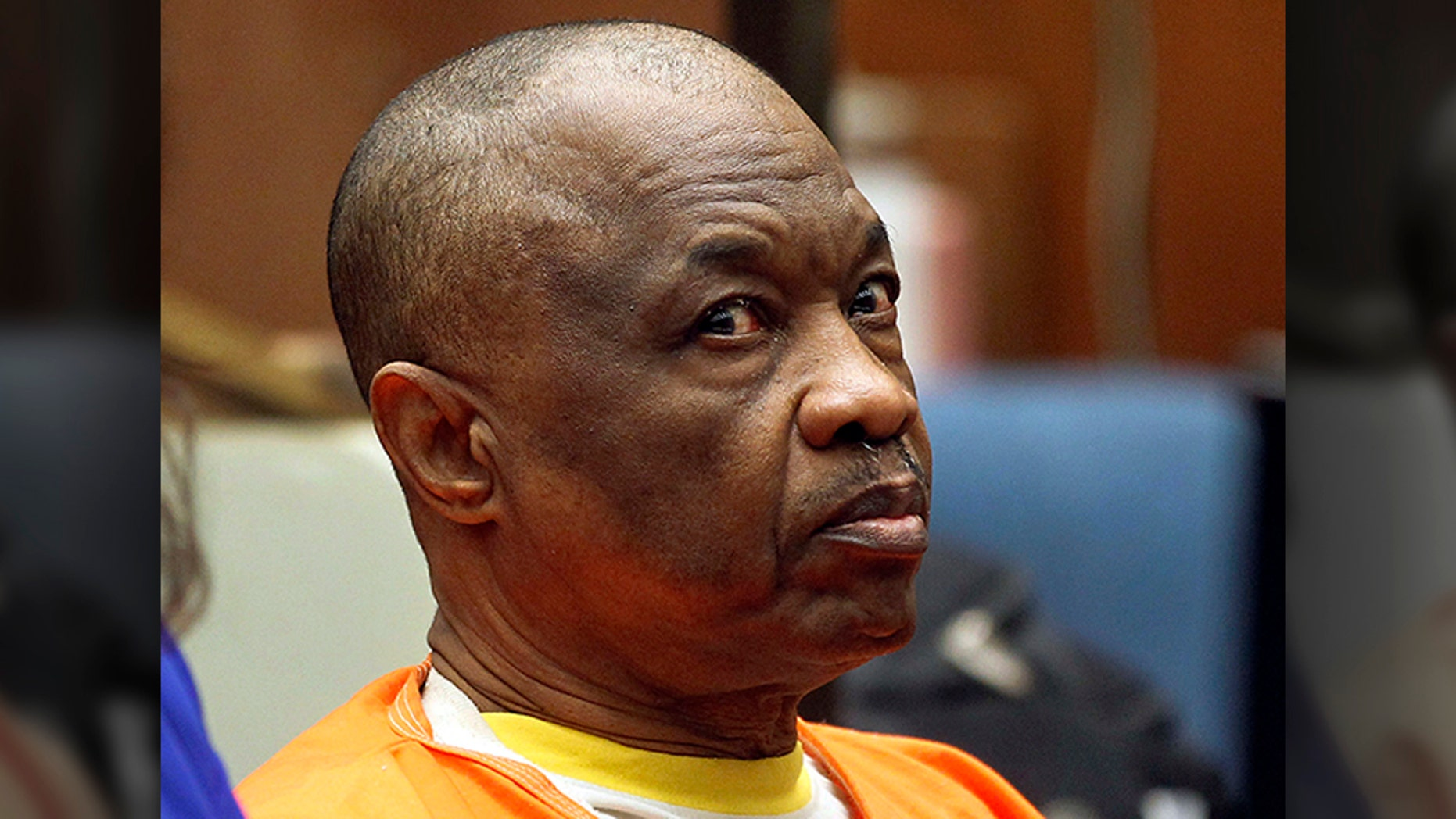 "FILE - In this Feb. 6, 2015, file photo, Lonnie Franklin Jr., who has been dubbed the ""Grim Sleeper"" serial killer, sits during a court hearing in Los Angeles. (AP Photo/Nick Ut, File)"