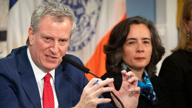 New York City Mayor Bill de Blasio, with Dr. Oxiris Barbot, commissioner of the city's Department of Health and Mental Hygiene, reports on the preparedness for the potential spread of the coronavirus on Feb. 26, 2020. (AP Photo/Mark Lennihan, File)