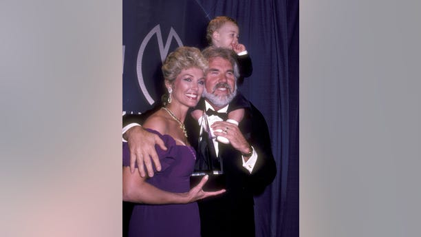 Musician Kenny Rogers, wife Marianne Gordon, and son Christopher Rogers attend the 10th Annual American Music Awards on January 17, 1983, at Shrine Auditorium in Los Angeles, California.