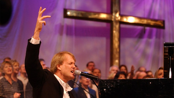 John Tesh played the piano and sang during the two services at Cherry Hills Community Church in Highlands Ranch.
