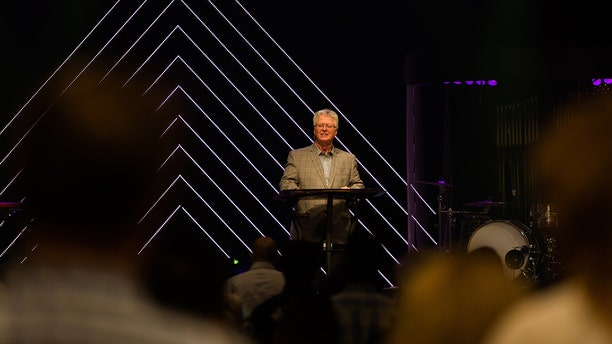 Tom Walters, the senior pastor of Word of Life Church, preaches to his congregation. This week he apologized for keeping the doors open for service Sunday amid the coronavirus pandemic.