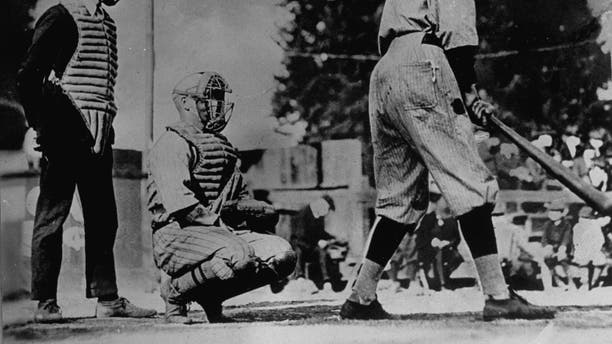Unident. baseball players, one batting and one catching, with umpire standing behind plate, wearing masks which they thought would keep them from getting flu during influenza epidemic of 1918. (Photo by Underwood And Underwood/Underwood And Underwood/The LIFE Images Collection via Getty Images/Getty Images)