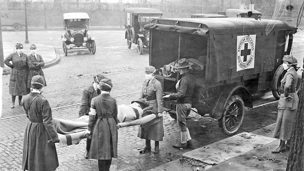 Members of the American Red Cross remove Spanish influenza victims from a house at Etzel and Page avenues in 1918.