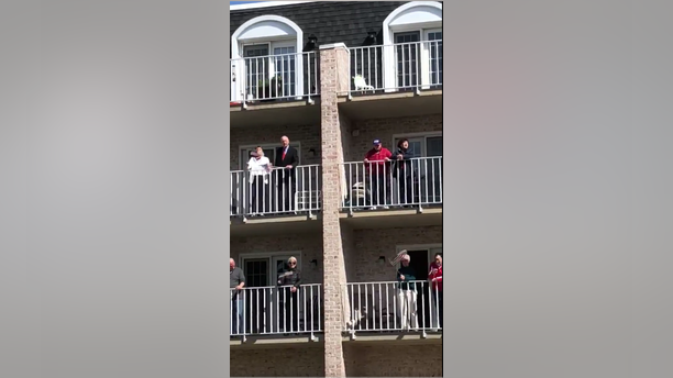 """Residents at the Willow Valley Communities in Lancaster, Pa. were videoed over the weekend singing """"God Bless America"""" on their balconies."""
