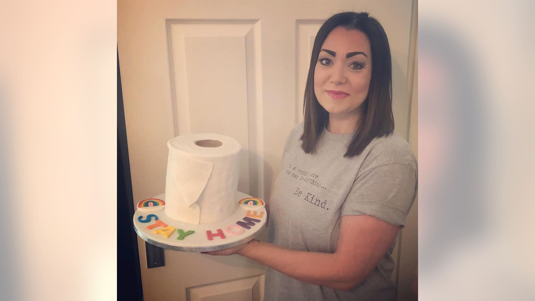 "Lisa Jamieson, 38, baked the chocolate fudge sponge cake on Tuesday evening, iced to look like a toilet roll, and emblazoned with icing letters spelling out ""STAY HOME."""