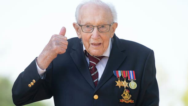 100-year-old war veteran Captain Tom Moore, poses for a photo at his home in Marston Moretaine, England, after he achieved his goal of 100 laps of his garden, raising millions of pounds for the NHS with donations to his fundraising challenge from around the world. (Joe Giddens/PA via AP)