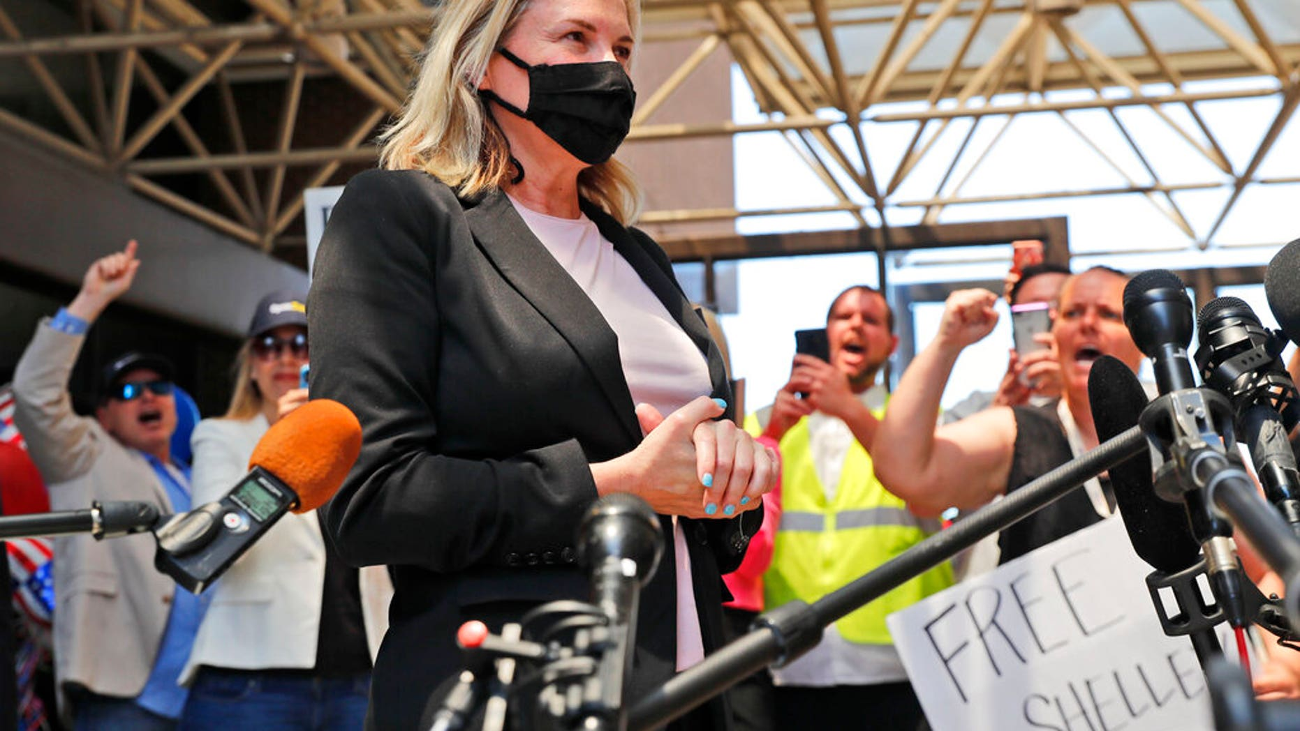 Salon owner Shelley Luther begins to speak to the media after she was released from jail in Dallas, Thursday, May 7, 2020. (AP Photo/LM Otero)