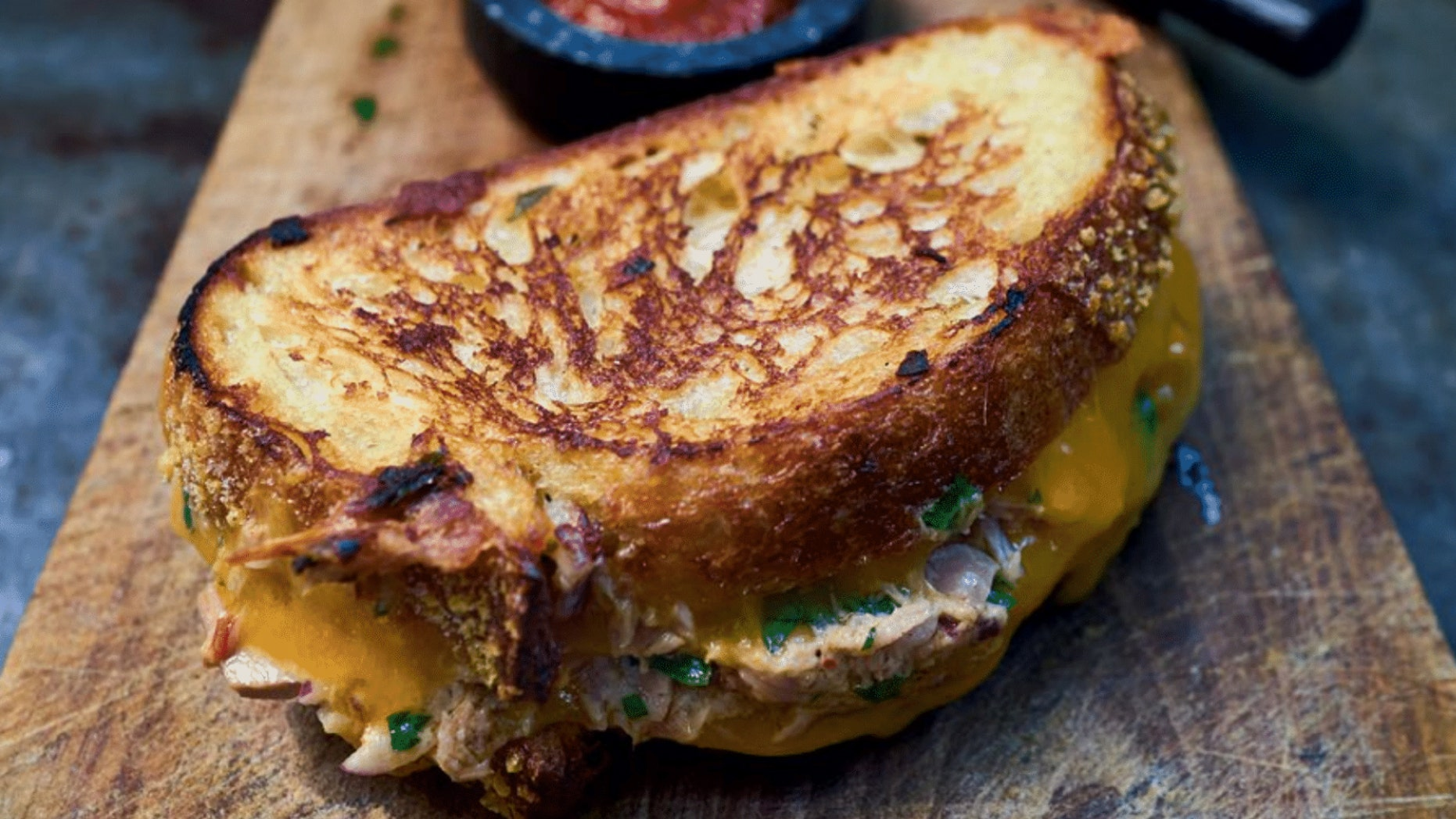 """This seemingly simple toasted sandwich with tuna and lots of cheese is a real American classic,"" writes Bart Van Olphen in his"