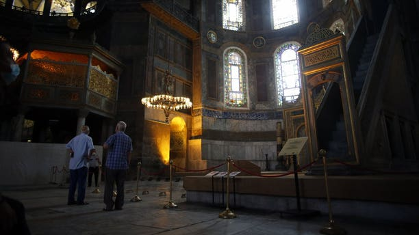 People visit the Byzantine-era Hagia Sophia, an UNESCO World Heritage site and one of Istanbul's main tourist attractions in the historic Sultanahmet district of Istanbul, Friday, July 10, 2020.
