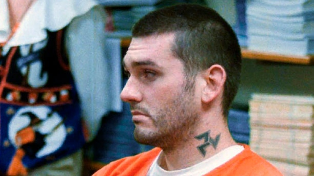In this Oct. 31 1997, file photo, Daniel Lewis Lee waits for his arraignment hearing for murder in the Pope County Detention Center in Russellville, Ark.