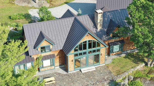 The property where Ghislaine Maxwell, former associate of late disgraced financier Jeffrey Epstein, was arrested by the Federal Bureau of Investigation (FBI) is seen in an aerial photograph in Bradford, New Hampshire, U.S. July 2, 2020.