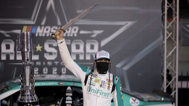 """Elliott holding the sword winners get at Bristol, which bills itself as """"The Last Great Colosseum."""""""