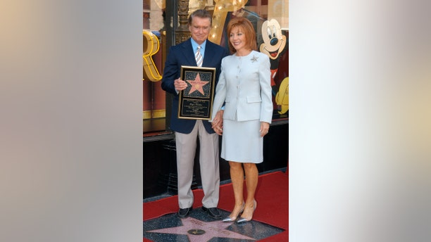 Regis Philbin and wife Joy Philbin during Regis Philbin Honored with a Star on the Hollywood Walk of Fame for His Achievements in Television at Hollywood Boulevard in Hollywood, California, United States.