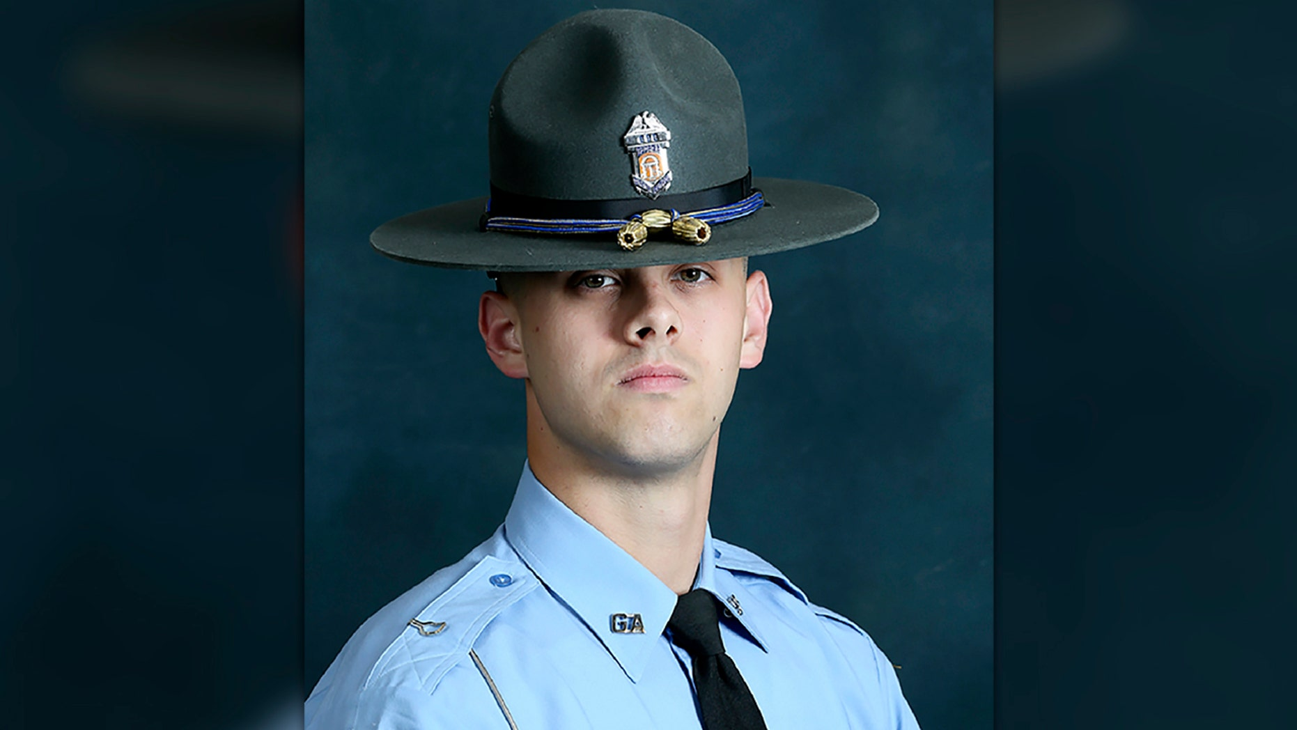 In this undated photo released by the Georgia Department of Public Safety, State trooper Jacob Gordon Thompson is seen in an official portrait. (Georgia Department of Public Safety via AP)